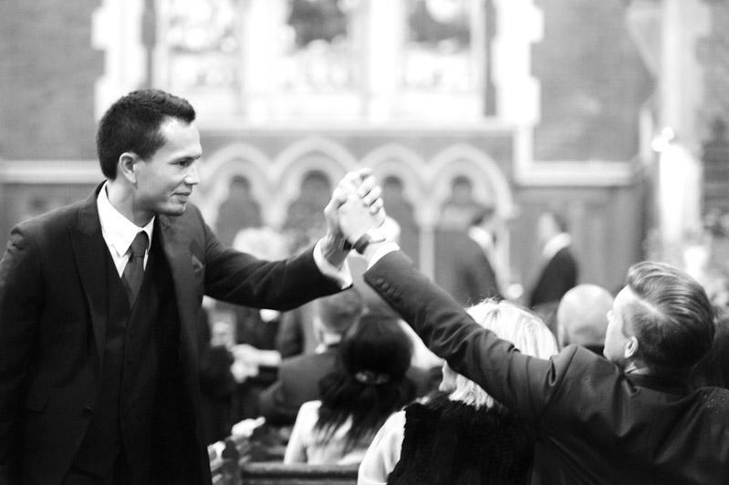 Groomsen handshake in church
