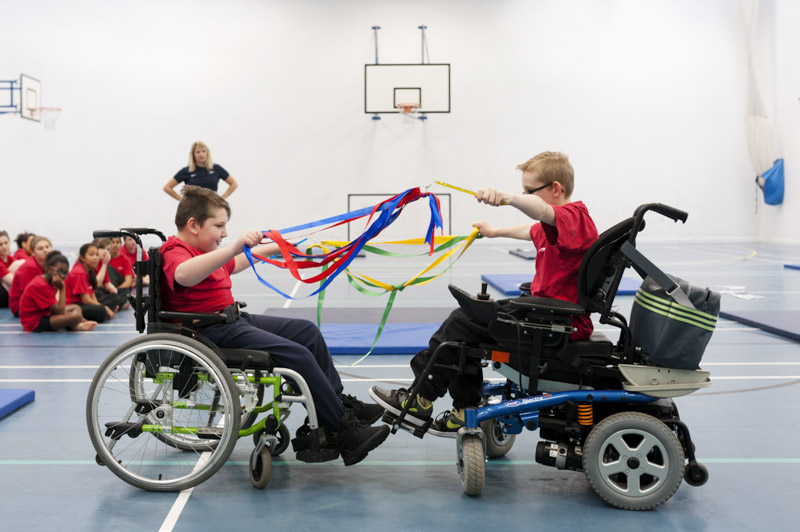 Wheelchair users doing PE in school