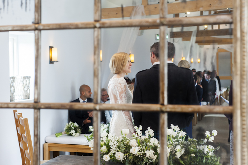 Southend Barns couple in the mirror during ceremony