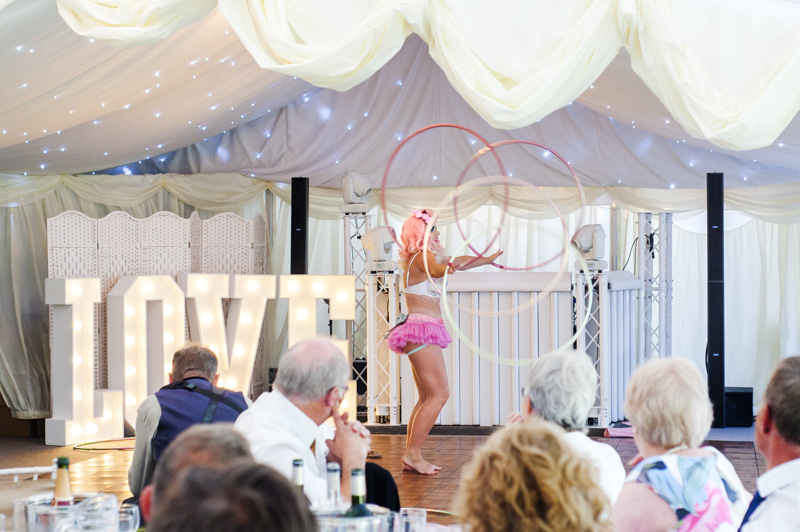 Burlesque performer at Hayne House wedding