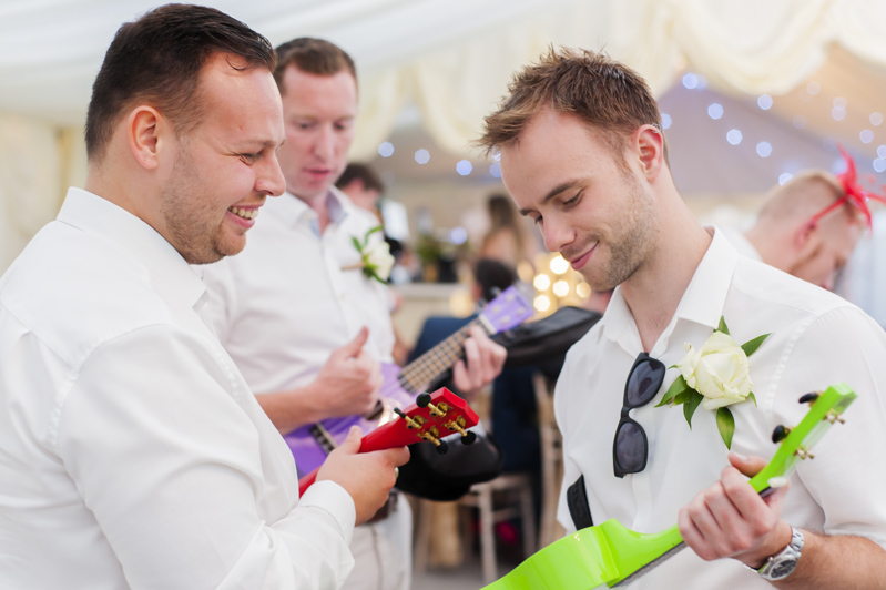 Groomsmen ukelele gifts at wedding reception