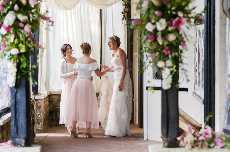 Bride laughing with bridesmaids at Hayne House wedding