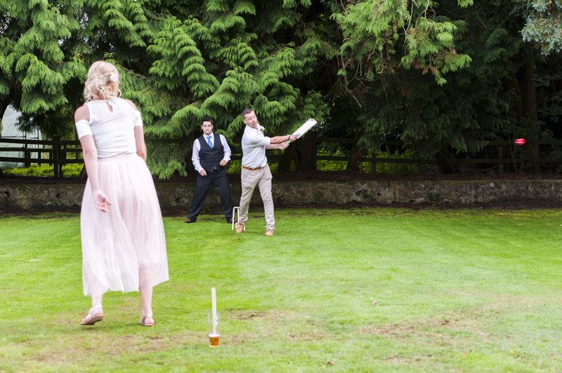 Wedding guests playing cricket at Hayne House