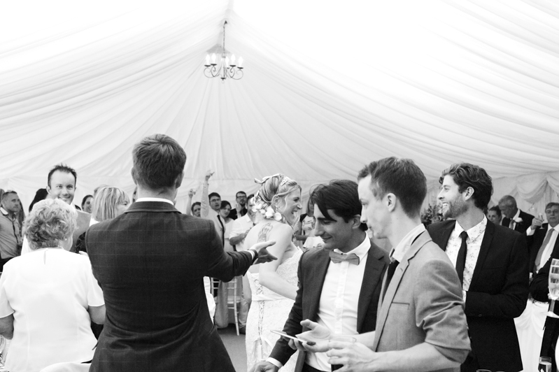 Bride and groom entering marquee