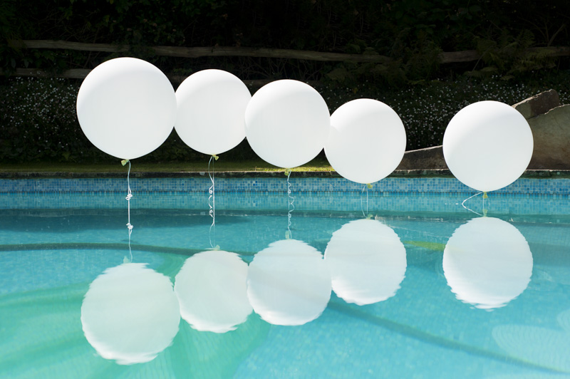 Balloons and swimming pool at wedding reception
