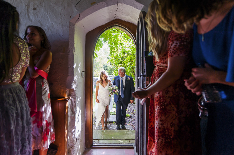 Bride and father entering chapel at Otham Court wedding