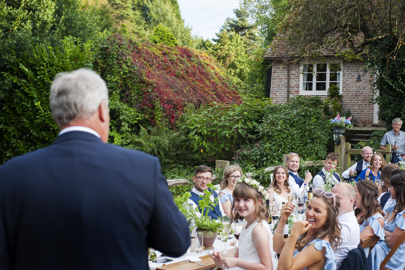 Speeches at outdoor wedding reception
