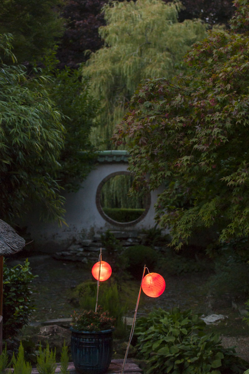 Lanterns in evening light in beautiful garden