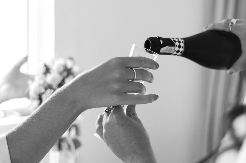 Pouring champagne during bridal preparations