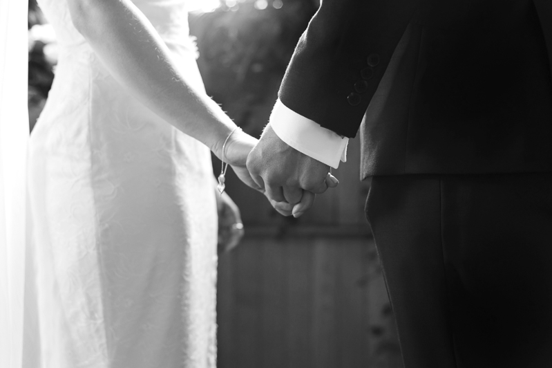 Bride and groom holding hands at Otham Court wedding