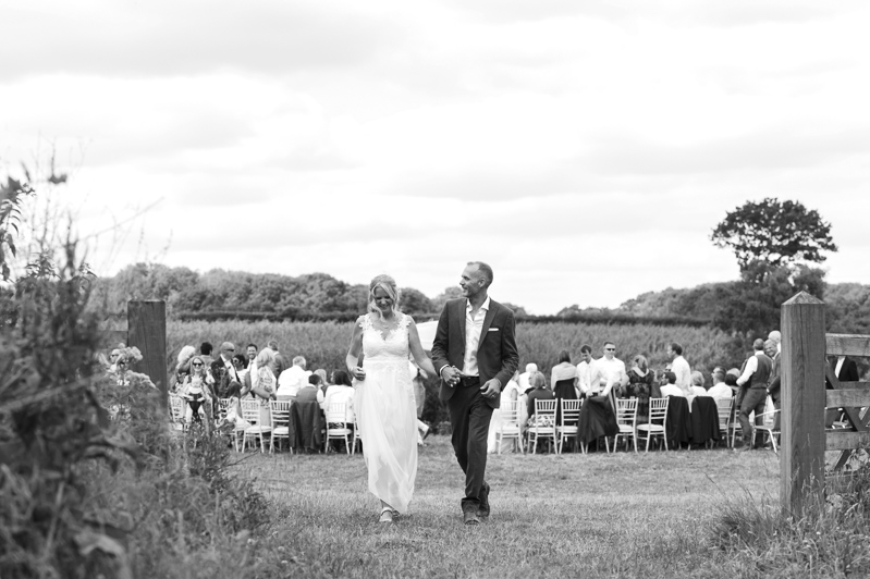 Couple after ceremony at Court Gardens Farm wedding