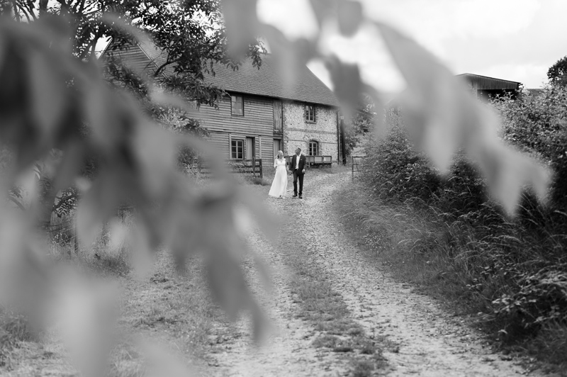 Couple walking down lane after Court Gardens Farm wedding