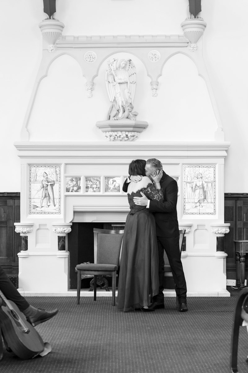Couple embracing after wedding ceremony