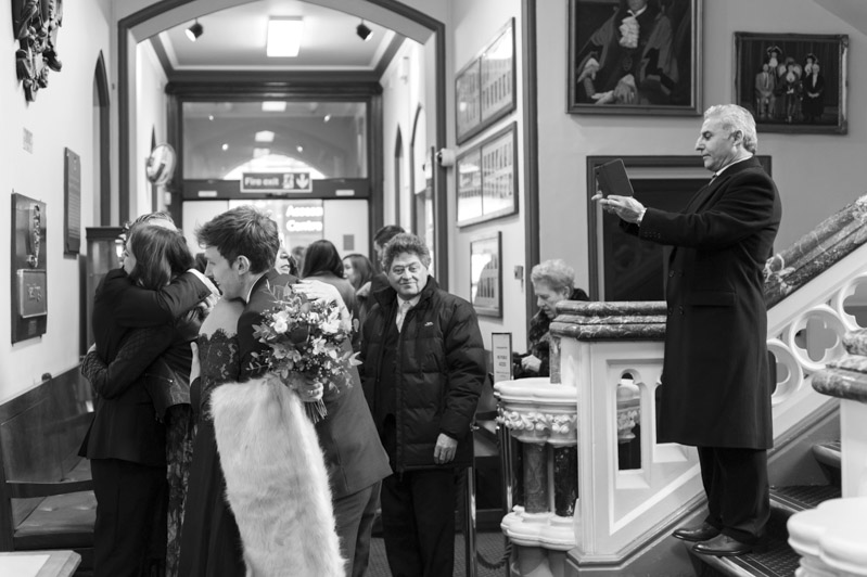 Guests congratulating couple - Hastings wedding photography