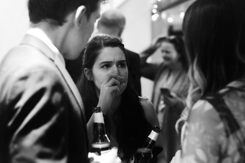 Guests chatting and drinking - Hastings wedding photography