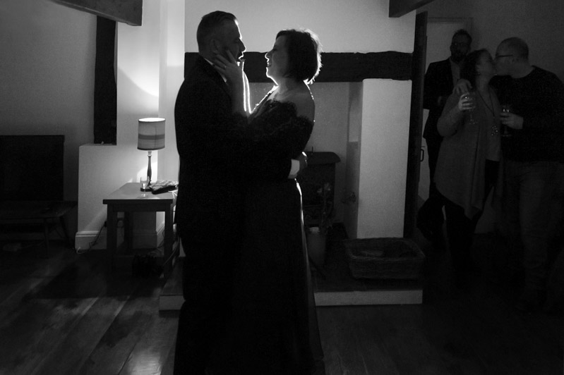 Couple dancing - Guests chatting and drinking