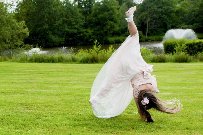 Child cartwheeling at wedding